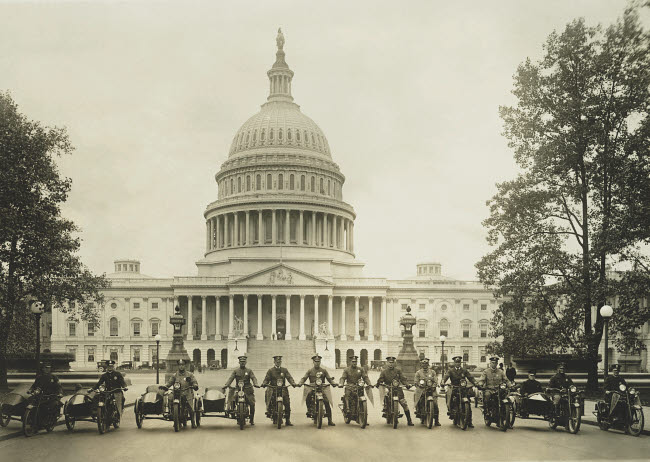 JPA101263M © Stocktrek Images, Inc. A group of motorcycle policemen in front of the U.S. Capitol building.