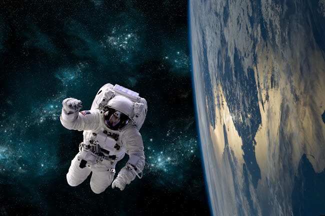 MRC200130S © Stocktrek Images, Inc. An astronaut floating above Earth.