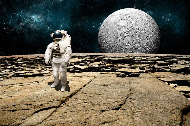 MRC200139S © Stocktrek Images, Inc. An astronaut on a barren planet with moon rising over the horizon.