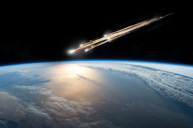 MRC200202S © Stocktrek Images, Inc. A meteor streaks towards a collision with Earth as it breaks up over the ocean.
