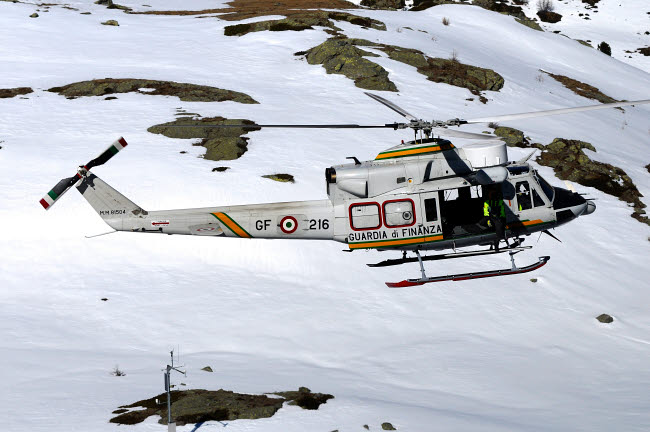 RCN100417M © Stocktrek Images, Inc. AB.412 helicopter from Guardia di Finanza flying over the Alps.