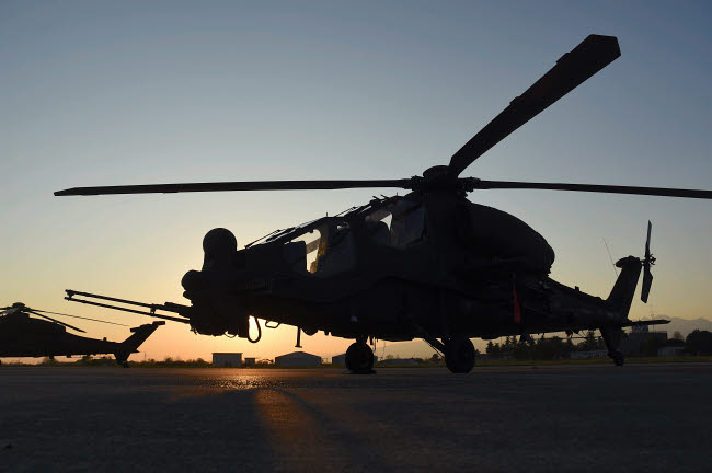RCN100419M © Stocktrek Images, Inc. AH-129D Mangusta Italian Army helicopter from 5th Regiment at sunset.