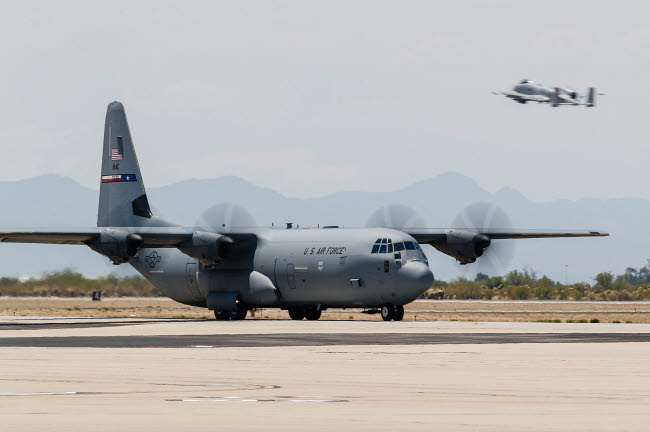 RDG100229M © Stocktrek Images, Inc. A C-130J Hercules taxies in after landing at Davis-Monthan Air Force Base.