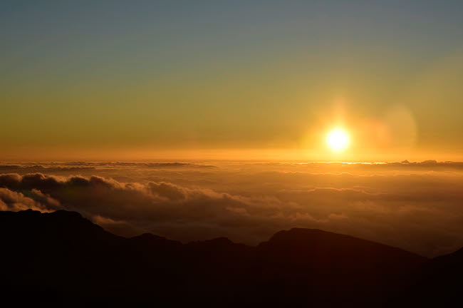 RYN100003T © Stocktrek Images, Inc. Sunrise over Haleakala Crater in Maui, Hawaii.