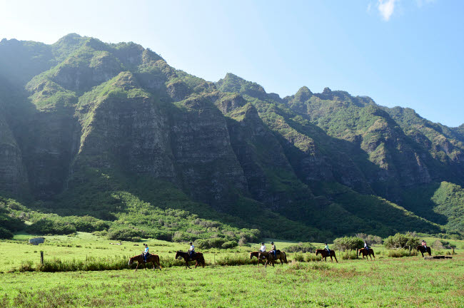 RYN100022T © Stocktrek Images, Inc. Horseback riding along the Ko'olau Range in Oahu, Hawaii.