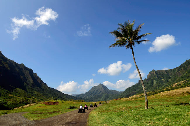 RYN100025T © Stocktrek Images, Inc. A group of ATV quad riders take to the trail near Ko'olau Range in Oahu, Hawaii.