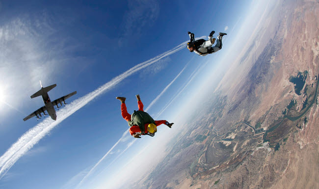 STK108776M © Stocktrek Images, Inc. A military freefall parachutist course student conducts a HALO jump.