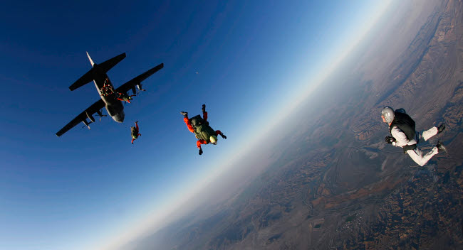 STK108777M © Stocktrek Images, Inc. Several military freefall parachutist course students exit an aircraft.