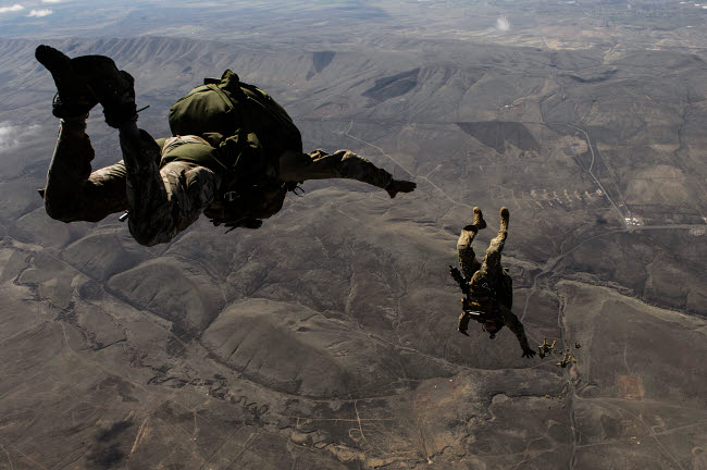 STK108783M © Stocktrek Images, Inc. U.S. Army soldiers conduct a HALO jump over Washington.