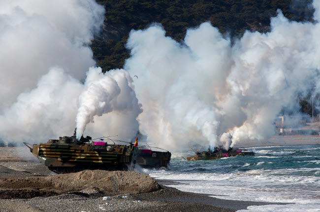 STK108889M © Stocktrek Images, Inc. Korean amphibious assault vehicles land on Dogu Beach, South Korea.