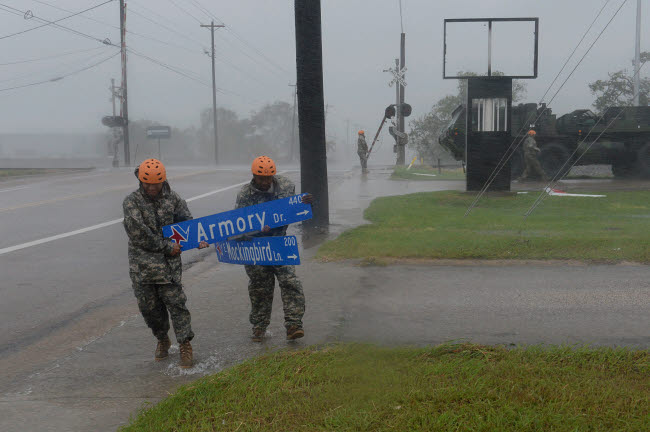 STK108923M © Stocktrek Images, Inc. U.S. Soldiers pick up large debris in the wake of Hurricane Harvey in Victoria, Texas.