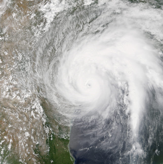 STK204718S © Stocktrek Images, Inc. Natural color satellite image of Hurrican Harvey making landfall on Texas.