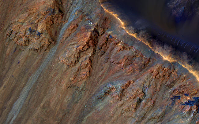 STK204771S © Stocktrek Images, Inc. Enhanced color close-up of the rim and inner slope of Krupac Crater on Mars.