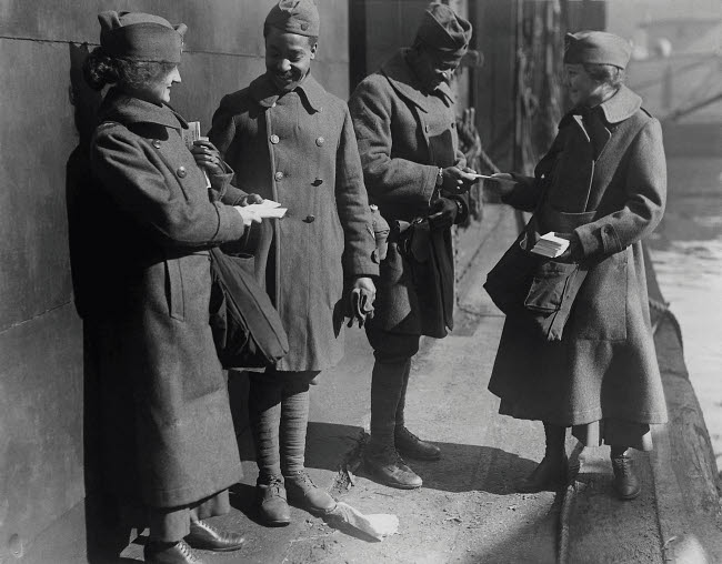 STK500263A © Stocktrek Images, Inc. Salvation Army lassies giving sweets to African American soldiers.