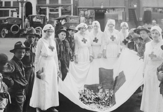STK500273A © Stocktrek Images, Inc. American Red Cross workers during a Red Cross parade.