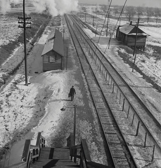STK500570A © Stocktrek Images, Inc. Conductor walks to the passenger station to wait for a suburban train to go home, 1943.