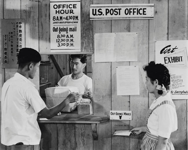 STK500697A © Stocktrek Images, Inc. Japanese Americans using postal service, 1942.