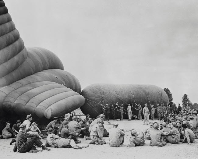 STK500737A © Stocktrek Images, Inc. Trainees observe an instructor on inflating a barrage balloon during World War II.