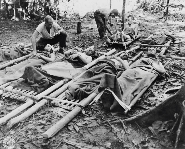 STK500813A © Stocktrek Images, Inc. Wounded American soldiers given medical attention in New Guinea, circa 1942-1945.