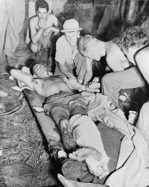 STK500842A © Stocktrek Images, Inc. A wounded American soldier gets a blood transfusion, New Guinea, circa 1942-1945.