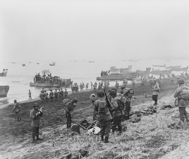 STK500844A © Stocktrek Images, Inc. Landing boats unload soldiers onto the beach at Massacre Bay, Attu Island, 1943.