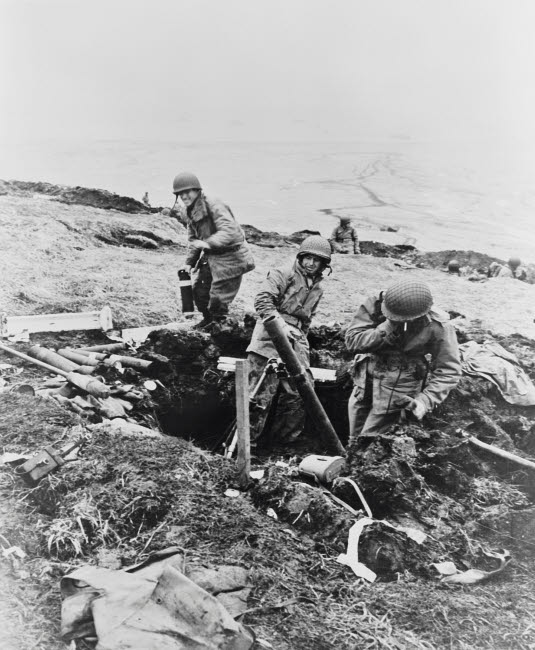 STK500845A © Stocktrek Images, Inc. Soldiers hurling their trench mortar shells over a ridge on the island of Attu, 1943.