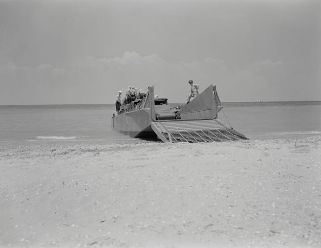 STK501036A © Stocktrek Images, Inc. Marines prepare to set a truck ashore from a fifty-foot ramp boat, 1942.