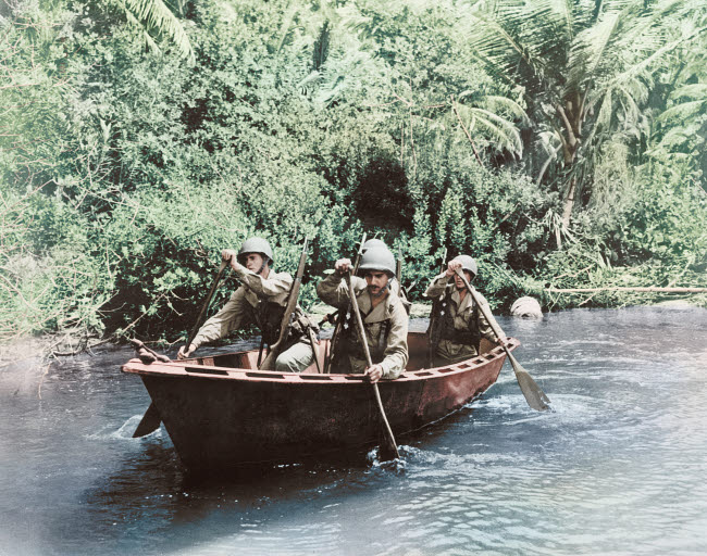 STK501287A © Stocktrek Images, Inc. U.S. troops patrolling the Caribbean area in an assault boat, circa 1942.