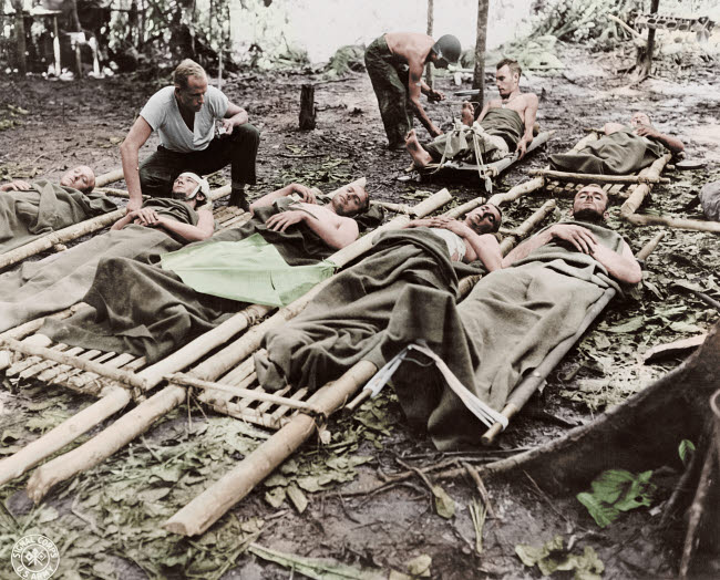 STK501308A © Stocktrek Images, Inc. Wounded American soldiers given medical attention in New Guinea, circa 1942-1945.