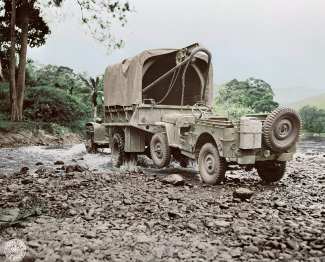 STK501318A © Stocktrek Images, Inc. A U.S. military truck with wrecker mount towing a jeep, 1942.
