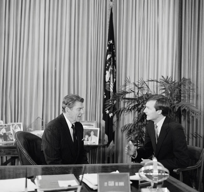 STK501367A © Stocktrek Images, Inc. Ronald Reagan at his desk in the Oval Office with a Republican Senator.