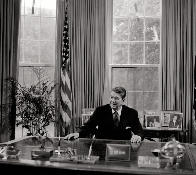 STK501368A © Stocktrek Images, Inc. President Ronald Reagan at his desk in the White House Oval Office.