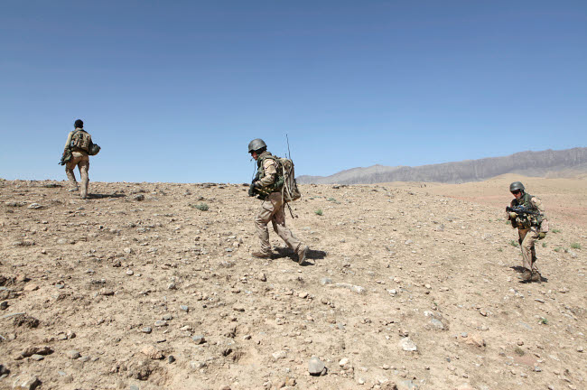 VWP100132M © Stocktrek Images, Inc. Dutch Army soldiers on foot patrol in Afghanistan.