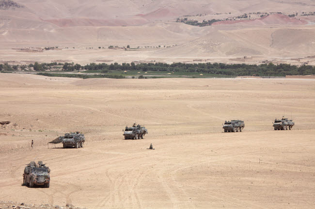 VWP100133M © Stocktrek Images, Inc. Convoy of Dutch Army vehicles in Afghanistan.