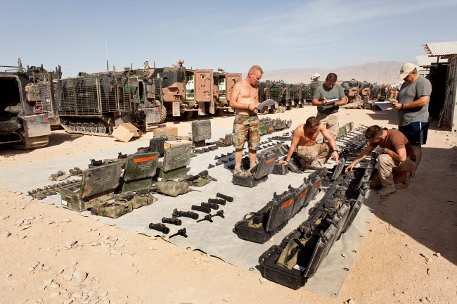 VWP100150M © Stocktrek Images, Inc. Dutch Army soldiers take inventory of weapons and supplies in Afghanistan.