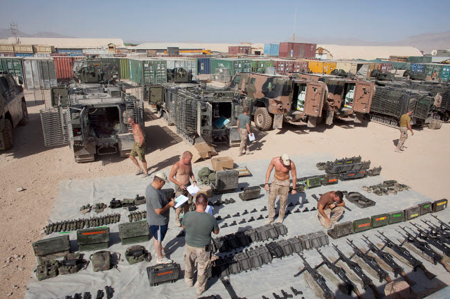 VWP100151M © Stocktrek Images, Inc. Dutch Army soldiers take inventory of weapons and supplies in Afghanistan.