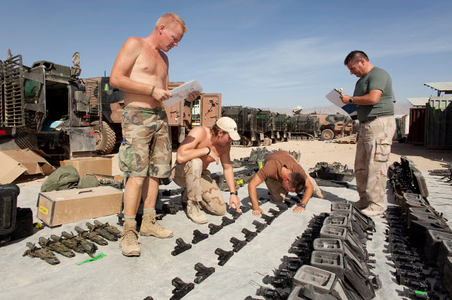 VWP100152M © Stocktrek Images, Inc. Dutch Army soldiers take inventory of weapons and supplies in Afghanistan.
