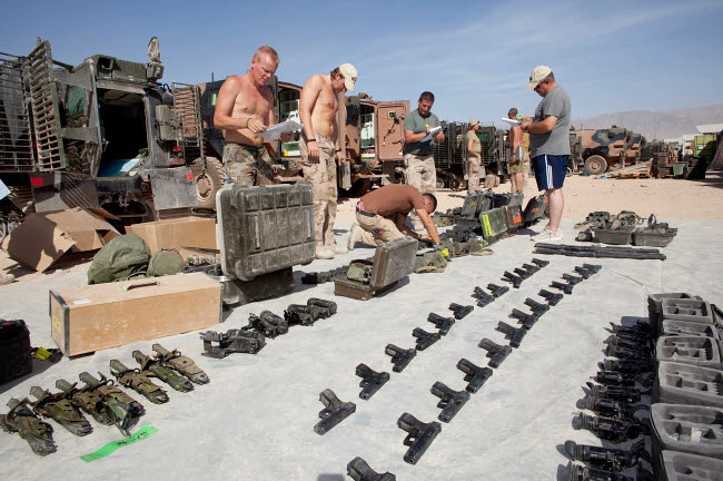 VWP100153M © Stocktrek Images, Inc. Dutch Army soldiers take inventory of weapons and supplies in Afghanistan.
