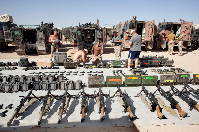 VWP100154M © Stocktrek Images, Inc. Dutch Army soldiers take inventory of weapons and supplies in Afghanistan.