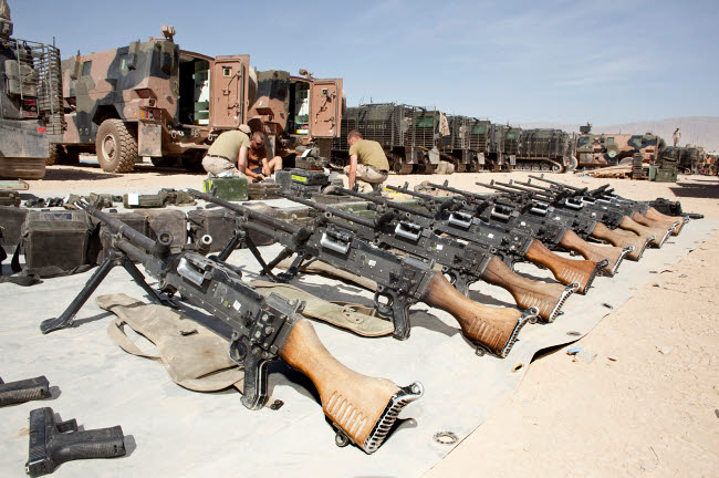 VWP100155M © Stocktrek Images, Inc. Dutch Army soldiers take inventory of weapons and supplies in Afghanistan.