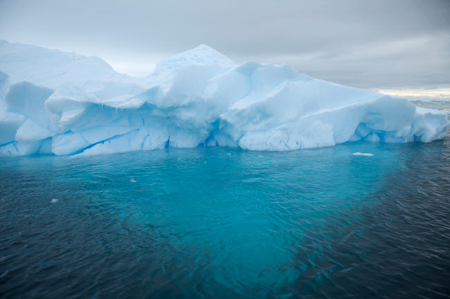 VWP200030S © Stocktrek Images, Inc. Iceberg grounded in shallow bay, Antarctica.