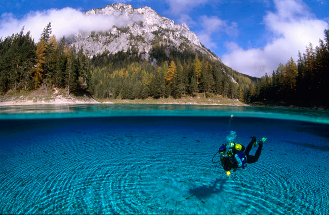 VWP401511U © Stocktrek Images, Inc. Diver exploring the Green Lake in Tragoss, Steiermark, Austria.
