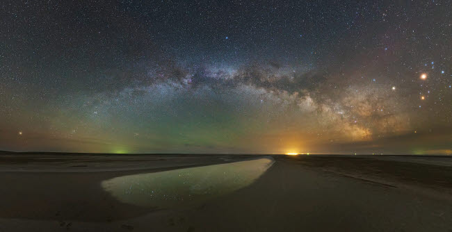 YZV200021S © Stocktrek Images, Inc. The arch of the Milky Way above Lake Elton salt lake in Russia.