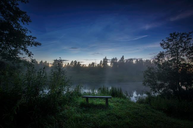 YZV200028S © Stocktrek Images, Inc. Lonely bench on the bank of the Sestra River in Russia.