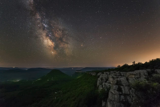 YZV200032S © Stocktrek Images, Inc. Milky Way over the forest covered mountains in Crimea.