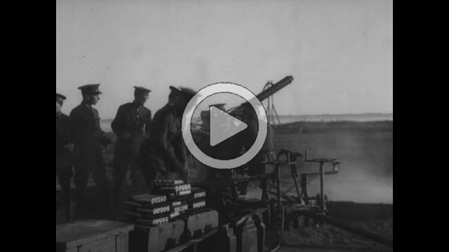 NAR800039F © Stocktrek Images, Inc. Film montage of military soldiers firing anti-aircraft guns.