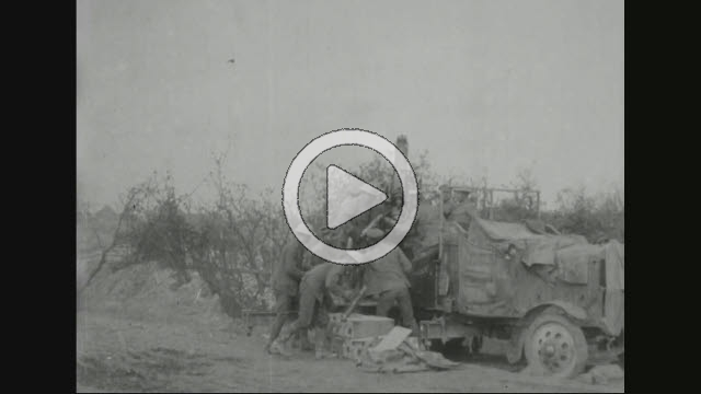 NAR800056F © Stocktrek Images, Inc. Film montage of military soldiers loading howitzer.