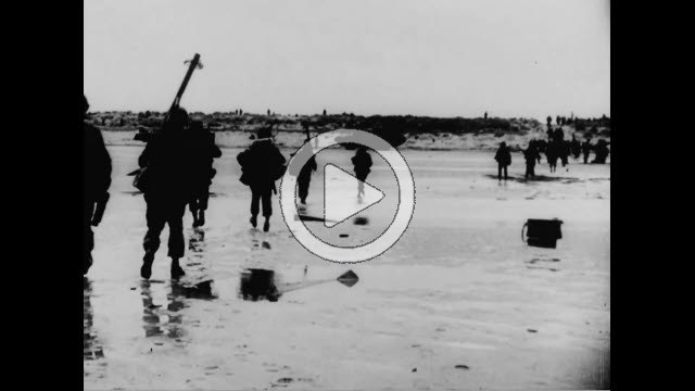 NAR800167F © Stocktrek Images, Inc. Wide shot of allied soldiers walking on beach in France.